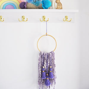 purple chunky yarn tassel wall hanging