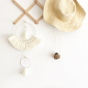 white tassel mobile wall hanging