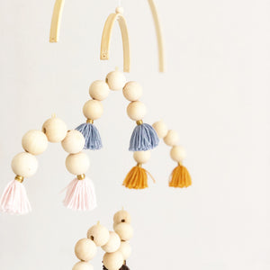 wooden rainbow mobile with tassels