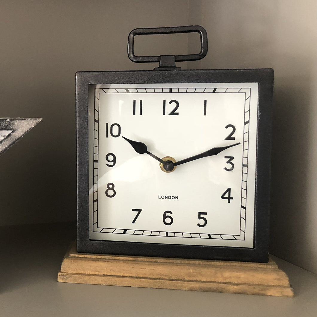 Vintage metal clock with wooden base, perfect for adding a classic touch to any home!  Size is 22cm x 18cm