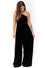 Front Image: black velvet floor length jumpsuit, with convertible top. Showing one shoulder option. Brand Two Birds