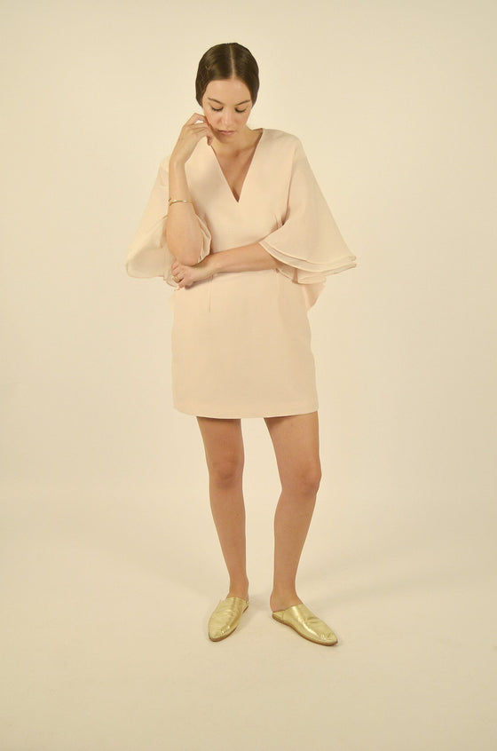 Front Image: Mini length, soft pink dress, with large sleeves, and deep v neckline.  Brand Keepsake.