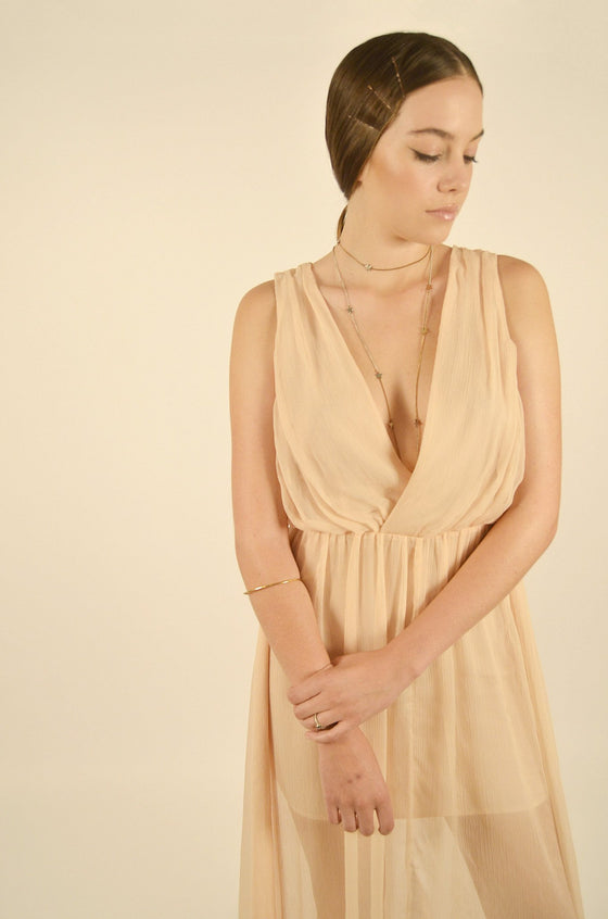 Front Image: biscuit colour, think straps, deep v neck link front and back, mid thigh slip, with flowing floor length illusion cover. Brand Keepsake.
