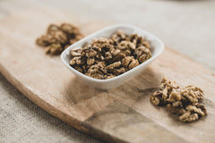 Bowl of walnuts on wooden board - Engin Akyurt