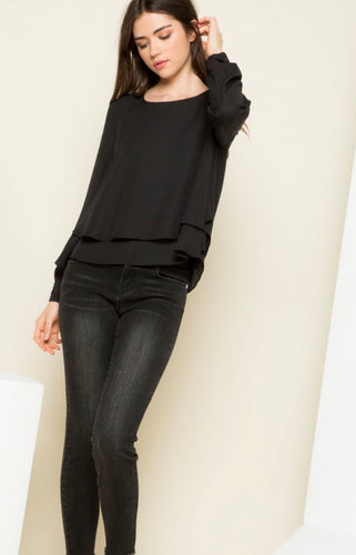Black blouse with ruffle detail on bottom
