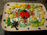 Bug cookies featuring lady bugs, grasshoppers, dragin flies, spiders, caterpillars and bees