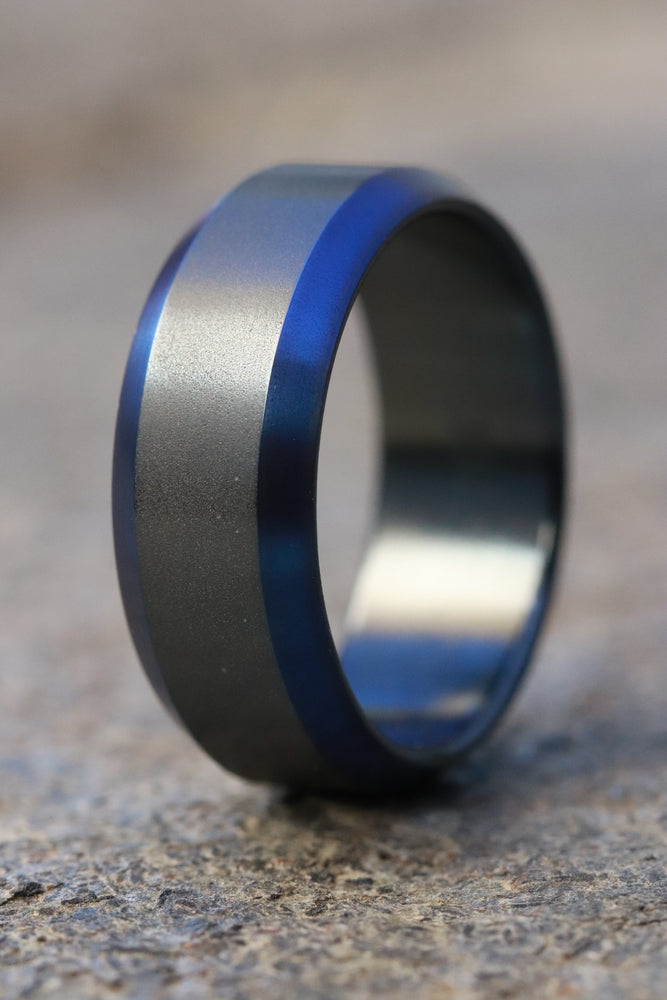 Black titanium ring 8mm wide blue / black chamfered titanium ring