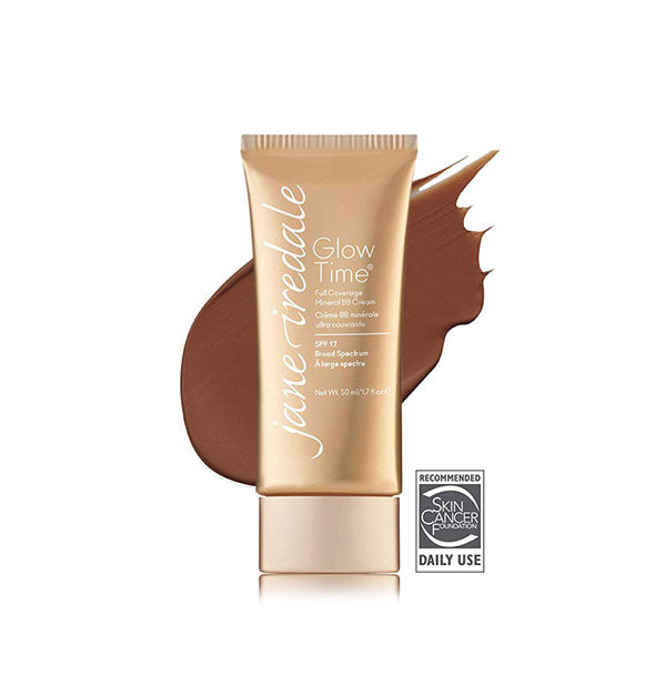 Gold-toned tube of Jane Iredale Glow Time Full Coverage Mineral BB Cream with sample swatch behind in the shade BB12.