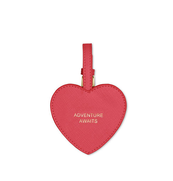 red heart luggage tag with gold text adventure awaits
