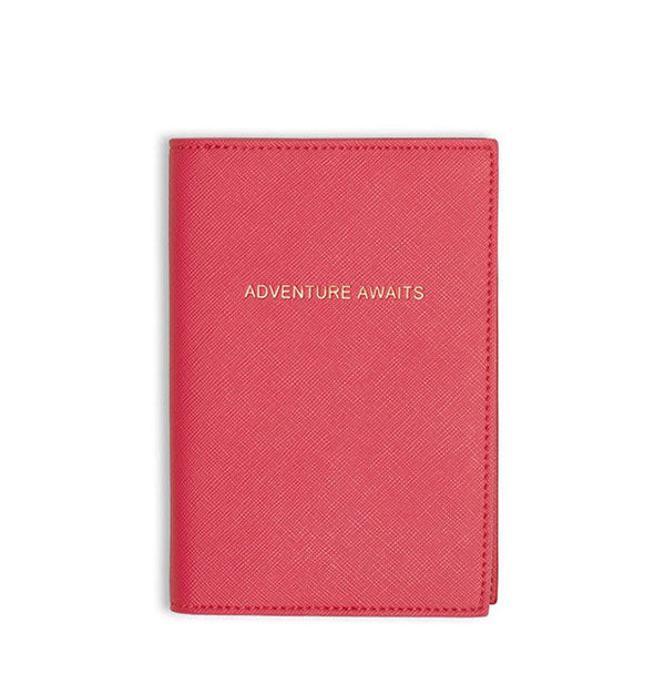 fushia passport holder with gold text adventure awaits