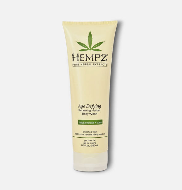 An off-white, 17-ounce bottle of Hempz Age Defying Herbal Body Moisturizer with green logo and accents and black pump nozzle.