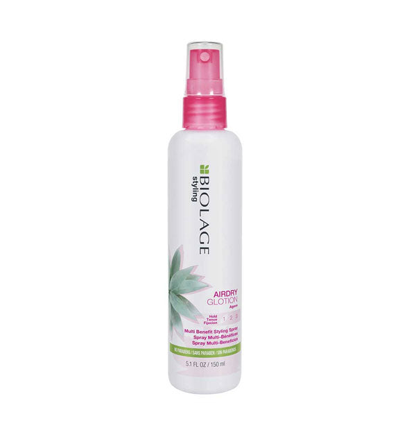 White 5.1-ounce bottle of Biolage Styling Airdry Glotion Multi Benefit Styling Spray with pink spray nozzle and green design accents.