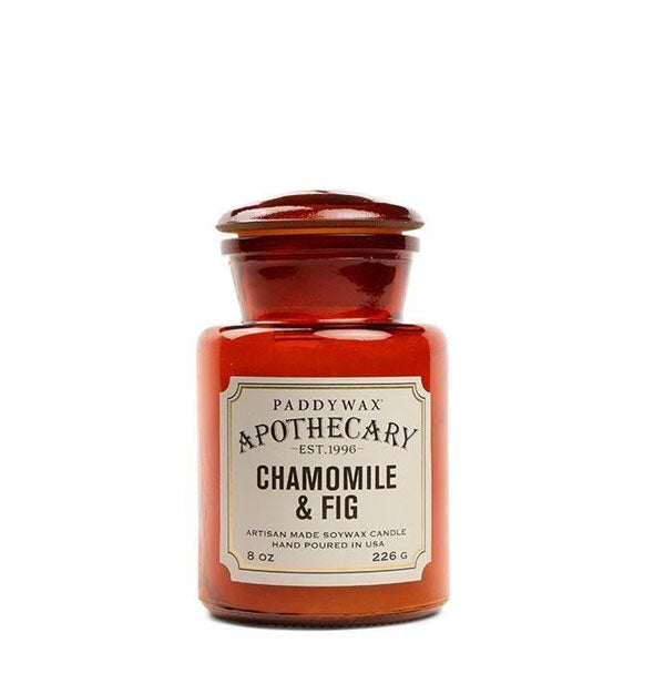 Amber 8-ounce glass apothecary-style candle jar with decorative off-white label.