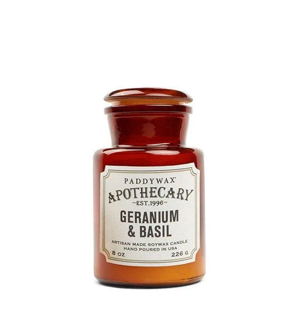 Amber 8-ounce glass apothecary candle jar with decorative off-white label.