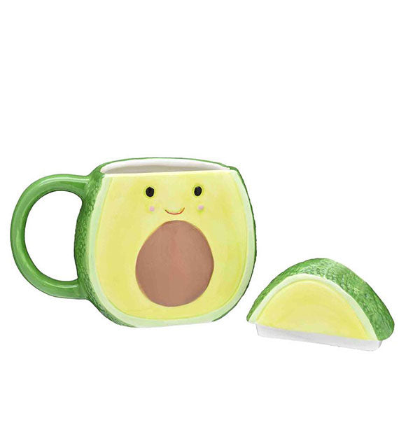 An avocado-shaped mug with lid removed.