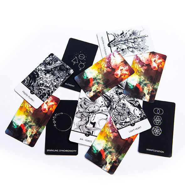 A smattering of cards with designs in both monochromatic and more colorful design schemes.