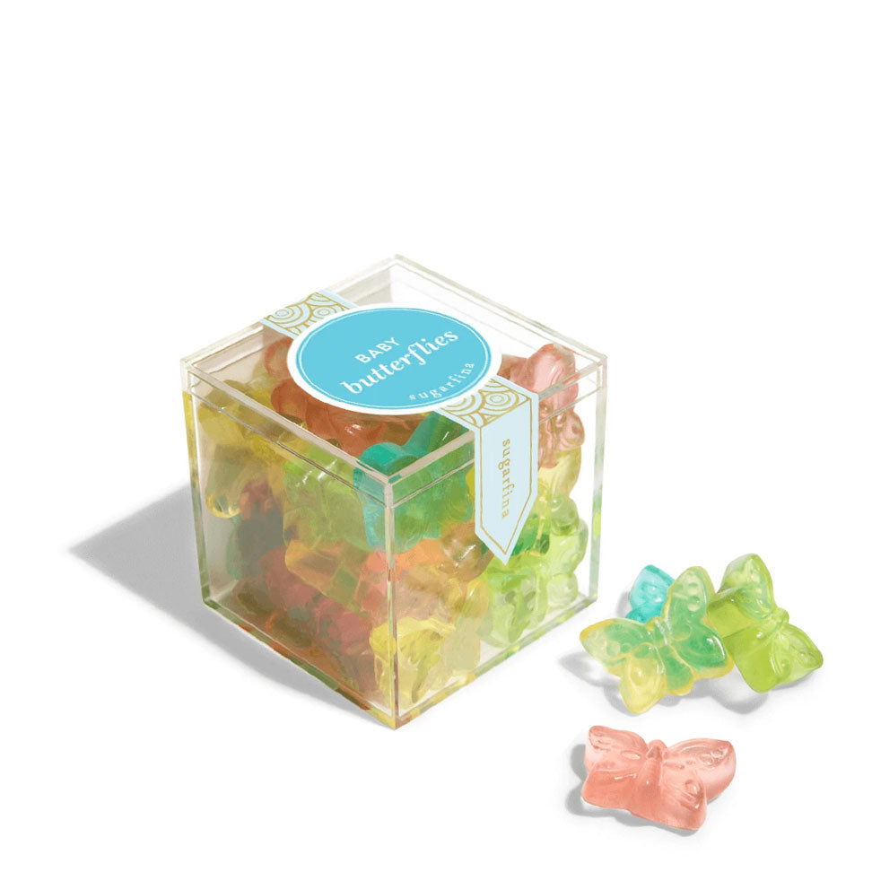 A small clear cube of Sugarfina Baby Butterflies gummy candies with several gummies displayed outside the packaging.