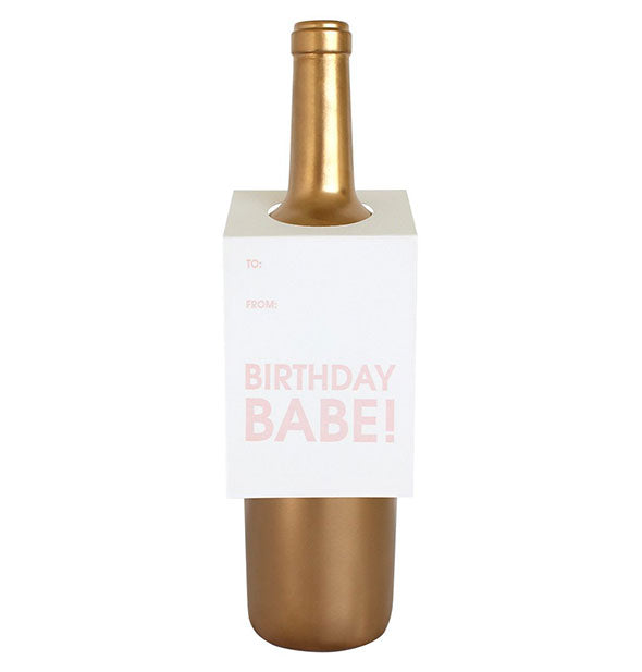 "A white tag labeled ""Birthday Babe!"" fits over the neck of a gold wine bottle."