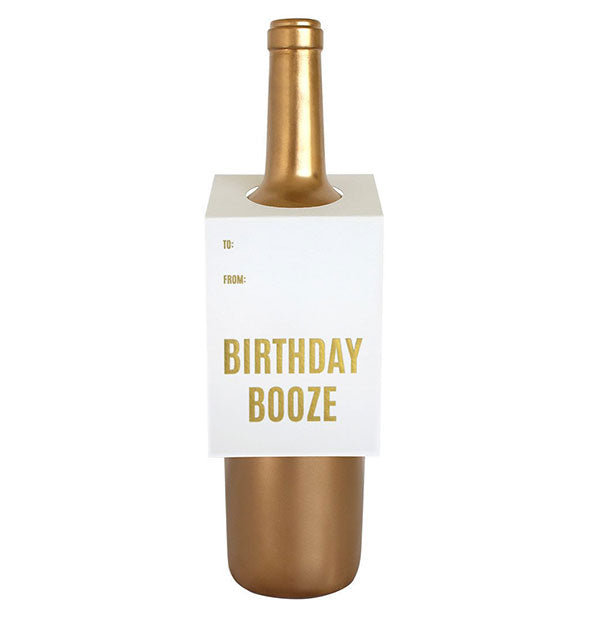 "A white tag labeled ""Birthday Booze"" fits over the neck of a gold wine bottle."