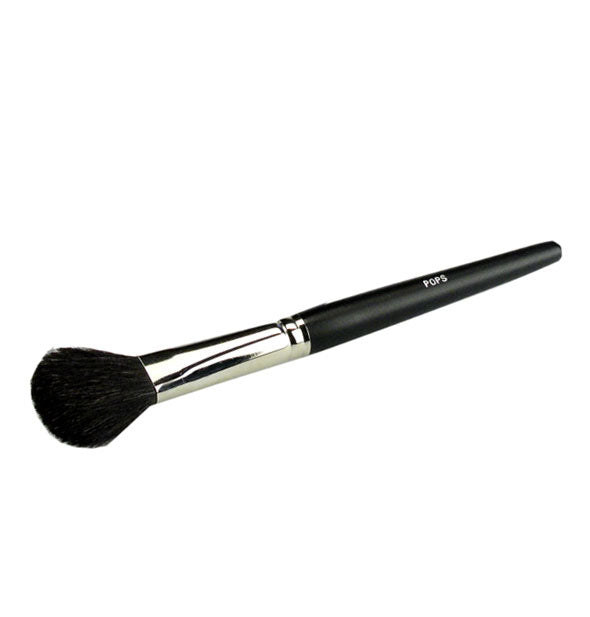 Rounded Pops Cosmetics makeup brush with nickel ferrule and black handle
