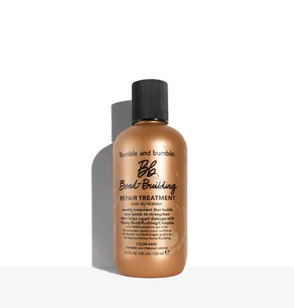 4.2 ounce bronze-colored bottle of Bumble and bumble Bond-Building Repair Treatment with black cap