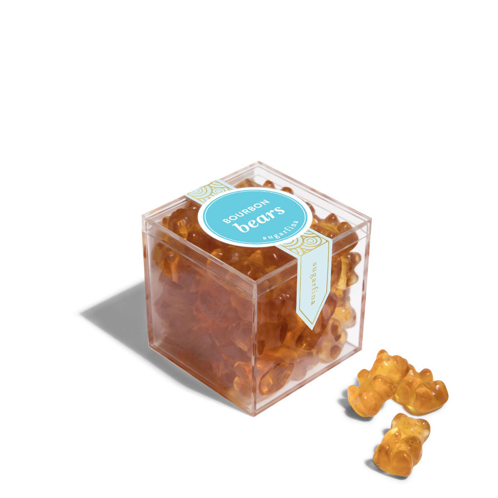 A small clear cube of Sugarfina Bourbon Bears gummy candies with several pieces displayed outside the packaging.