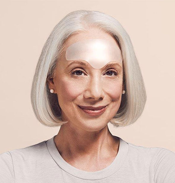 A picture of a woman wearing BrowLift Overnight Wrinkle Smoothing Patch