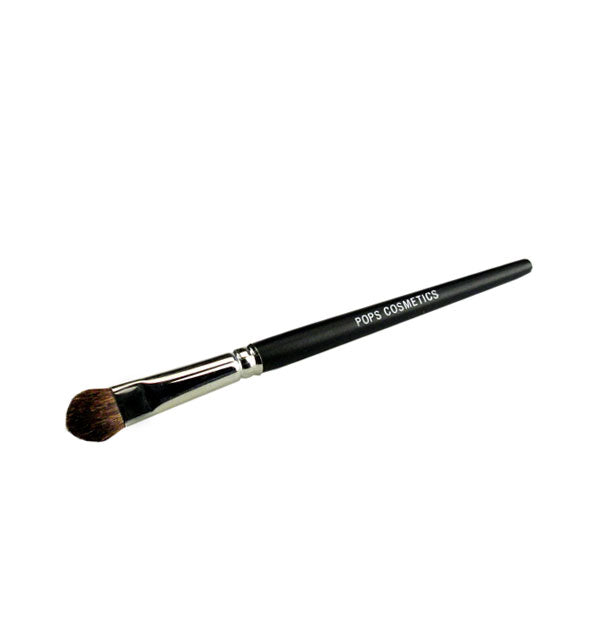 Rounded-tip Pops Cosmetics makeup brush with nickel ferrule and black handle