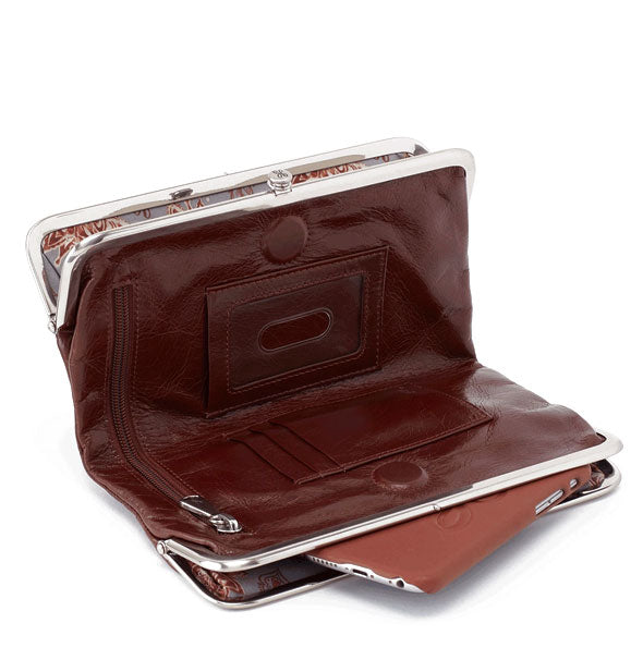 Open dark brown leather wallet with silver hardware