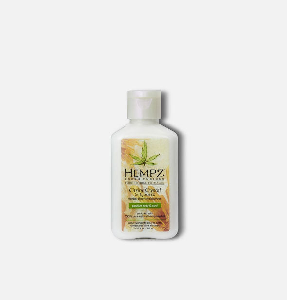 A white 2.25-ounce travel size bottle of Hempz Citrine Crystal & Quartz Herbal Body Moisturizer with multicolor label and pump nozzle.
