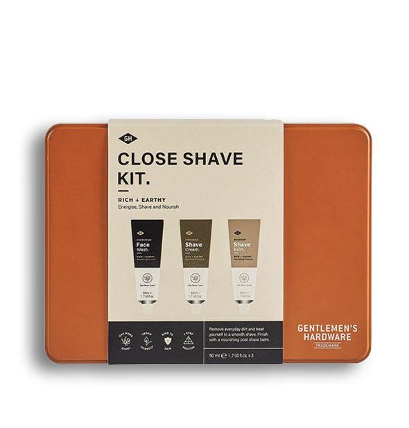 Orange rectangular Close Shave Kit tin with label