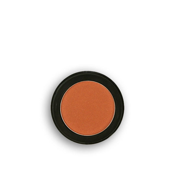 Warm terra cotta-colored pressed powder eyeshadow