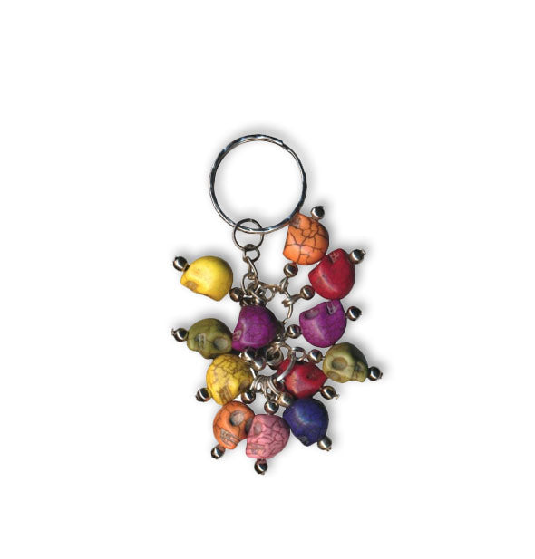 Colorful skulls clustered on a metallic keyring