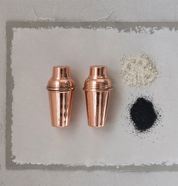 Pair of copper salt and pepper shakers that resemble cocktail shakers