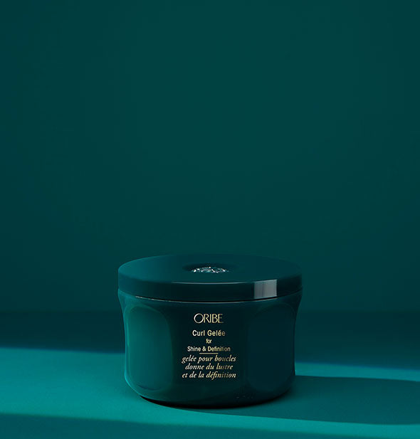 Teal pot of Oribe Curl Gelée for Shine & Definition on matching background