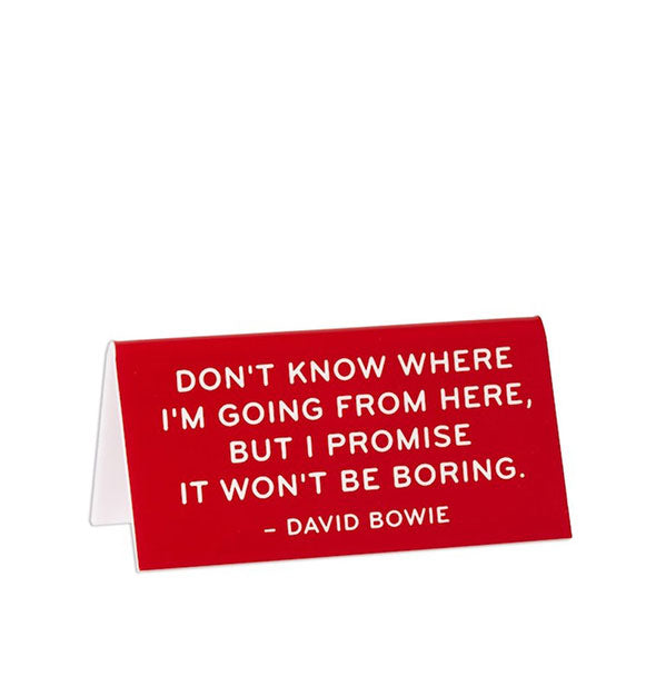 """Don't know where I'm going from here, but I promise it won't be boring"" – David Bowie red with white lettering desk sign by The Found."