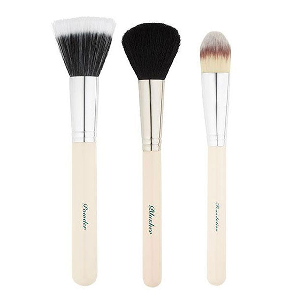 The Essential Face Brush Set with the 3 brushes displayed out side of the packaging