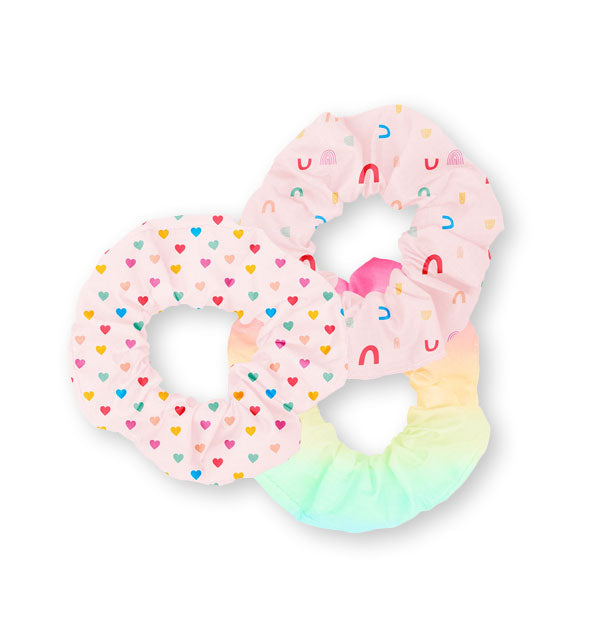 Three hair scrunchies in rainbow prints