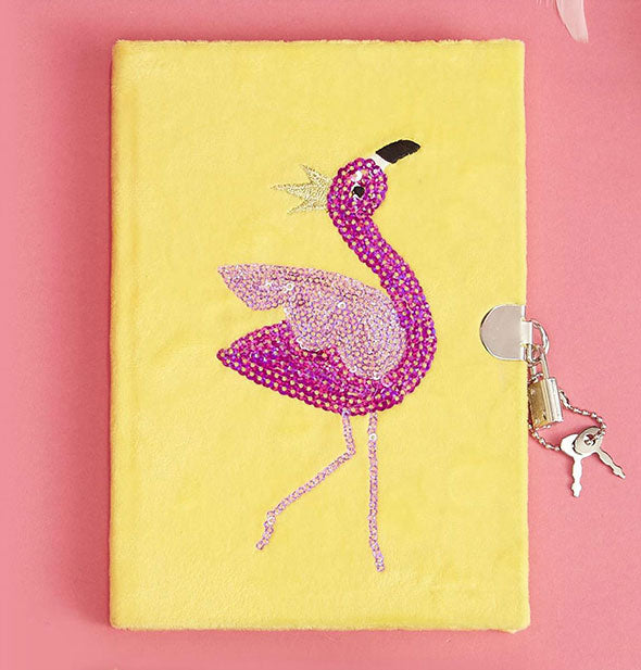 Textured yellow diary with pink rhinestone flamingo graphic and padlock with keys