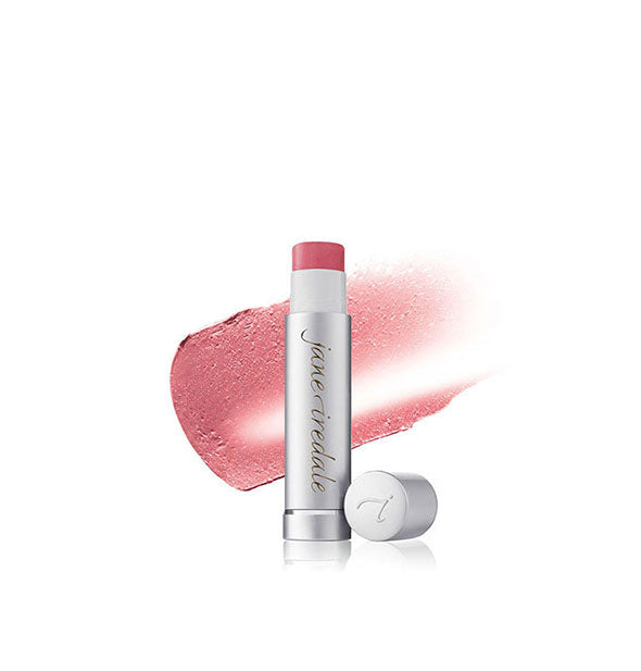 A tube of Jane Iredale LipDrink Lip Balm with stroke sample behind in the shade Flirt.
