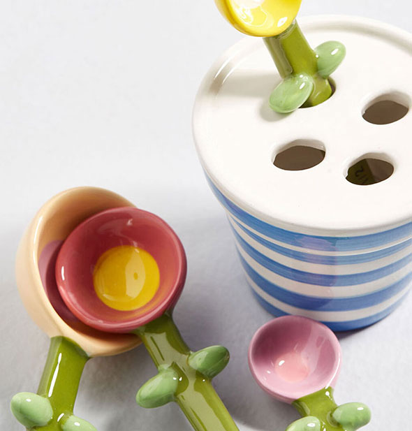 Ceramic flower measuring spoons with striped pot
