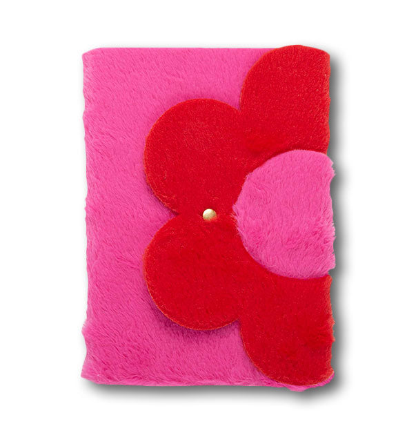 Journal with pink and red faux fur cover with flower design and gold snap in the middle