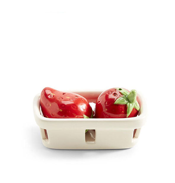 Strawberry salt and pepper shakers in ceramic basket