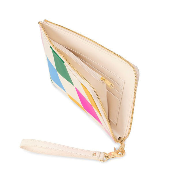 Wristlet clutch partially unzipped to show interior