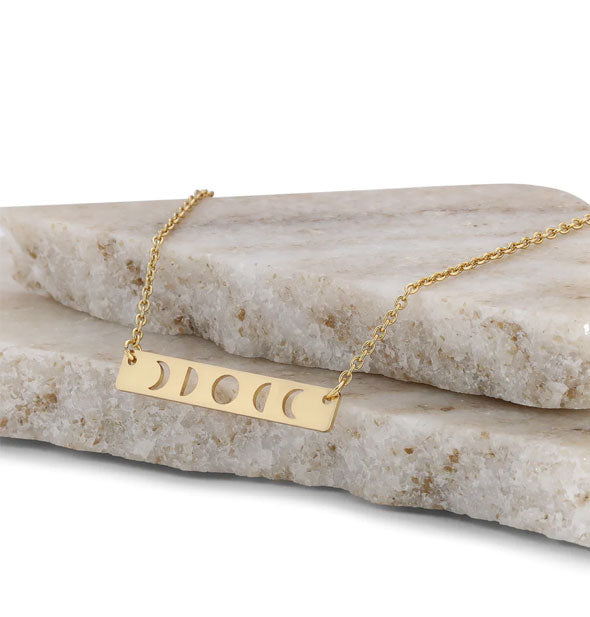 An open pot of Jane Iredale Smooth Affair for Eyes Shadow/Primer in the shade Gold.