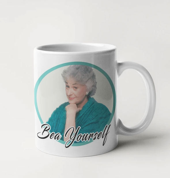 "White coffee mug with likeness of the Golden Girls TV show character Dorothy Zbornak as played by Bea Arthur says, ""Bea Yourself"""