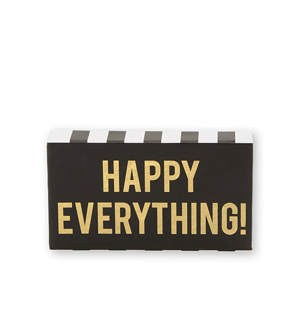 "Black ""Happy Everything!"" gift box with black and white stripes and gold lettering"