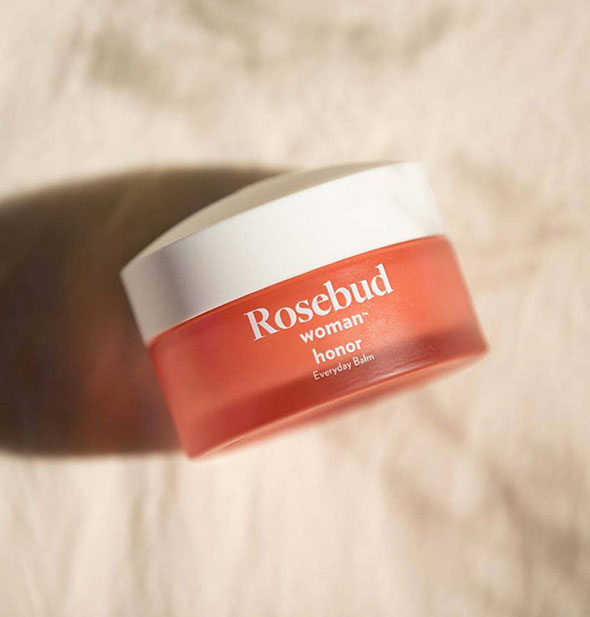 Jar of Rosebud Woman Honor Everyday Balm on marble surface