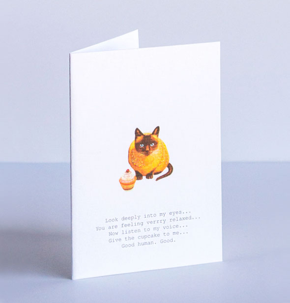 "Cat with cupcake greeting card says, ""Look deeply into my eyes... You are feeling verrry relaxed... Now listen to my voice... Give the cupcake to me... Good human. Good."""