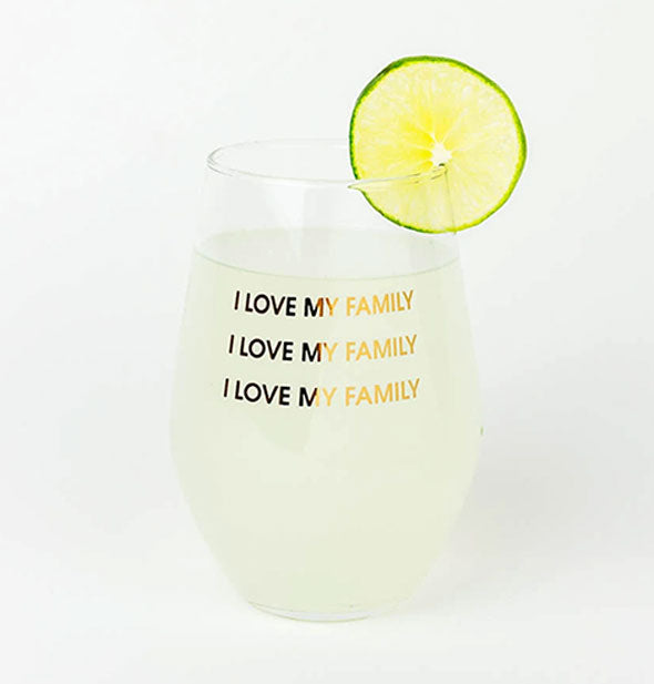 I Love My Family Stemless Wine Glass staged with a beverage inside and lime garnish on the rim.